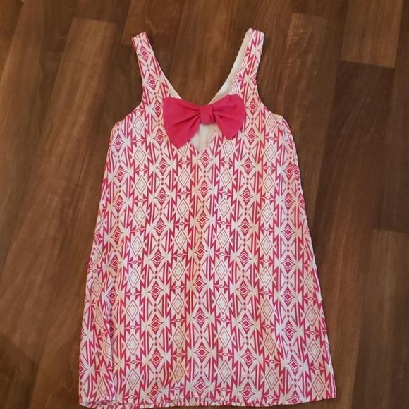 myan Dresses & Skirts - Geometric dress. Bow in BACK!